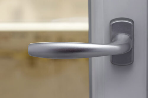 New and modern silver door handle - close up view