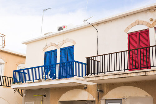 balcony with red door and blue door.